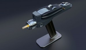 Phaser displayed on magnetic stand with tip glowing yellow