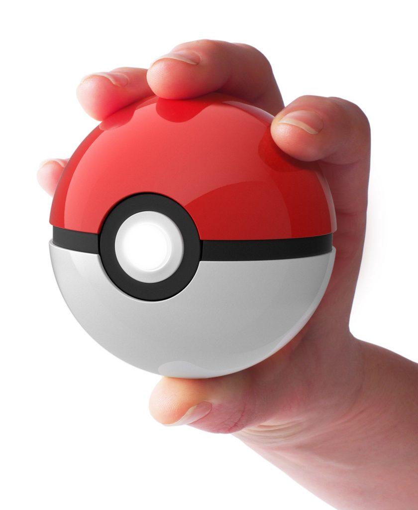 hand holding Poké Ball